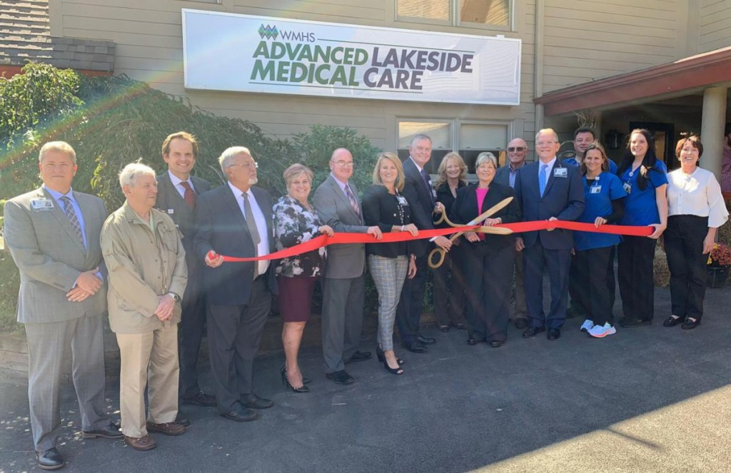 "Pictured at the ribbon cutting, from left, are James Karstetter, WMHS vice president and chief nursing officer; Kim Leonard, WMHS board of directors; Matt Gilmore, WMHS general counsel; Dr. Gerald Goldstein, WMHS vice president and chief medical officer; Karen Ullery, WMHS clinics and practices manager; Jeff O'Neal, WMHS executive director of clinics, practices, behavioral health services; Michelle Martz, WMHS vice president physician enterprise; Barry Ronan, WMHS president and CEO; Shelley Waugh, LAI architect; Nancy Adams, WMHS senior vice president and chief operating officer; Carl ""Buck"" Belt, Belt Construction; Kevin Turley, WMHS vice president and chief strategy officer; Erica Hook, respiratory therapist; Chad Brown, licensed practical nurse; Marissa Mullenax, licensed practical nurse; and Karen Myers, building owner."
